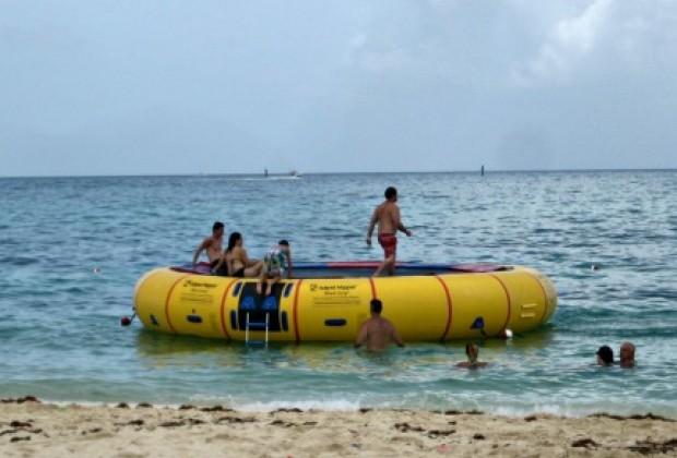 The fun water trampoline at the water's edge.