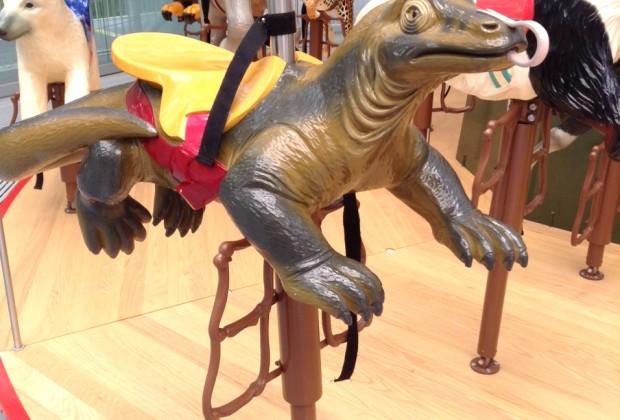 The carousel features two-dozen creatures to ride, including a Komodo dragon...