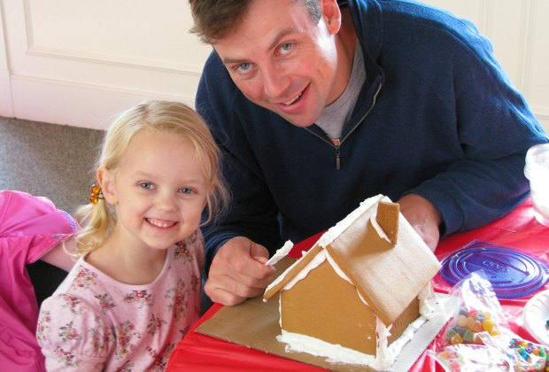 Decorating a gingerbread house is a sweet holiday tradition for the whole family.