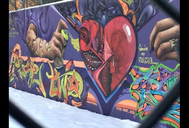 Part of the Graffiti Hall of Fame is in a schoolyard that isn't always open,<br/> but you can still see the art through the fence