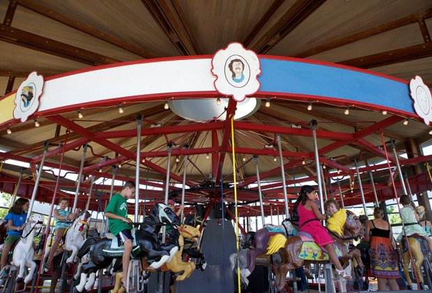 Take a ride (or two!) on the antique carousel at Mitchell Park. Photo courtesy of Greenport Village
