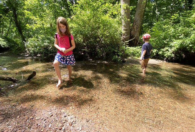 Hiking Games for Kids That Turn Walks into Adventures: kids wading in the water in a pond