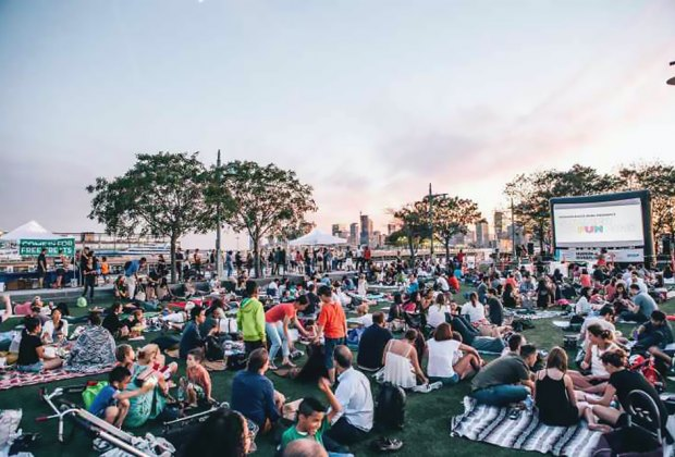 Pack a picnic dinner and relax with a movie at Hudson RiverFlicks for Kids in Hudson River Park . Photo courtesy of Hudson River Parks