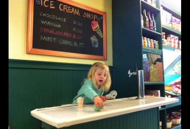 A play store features an ice cream counter and pretend packaged foods