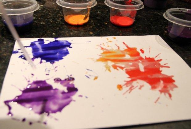 Blow paint across paper
