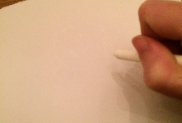 Draw with white crayon on paper