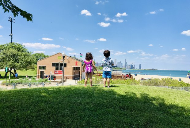 Two little Chicagoans, fresh from the splash pad at 31st Street Harbor, contemplate going to the beach.