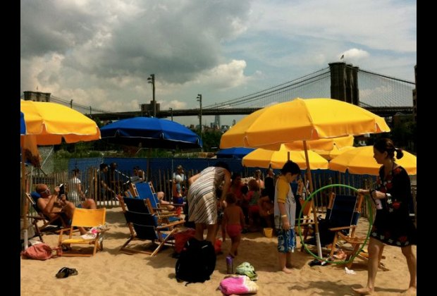 View of the Brooklyn Bridge from your beach chair are nice