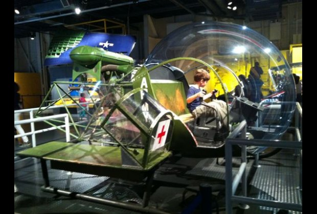 Pretending to pilot a Bell 47 helicopter in the massive Exploreum, where touching is encouraged