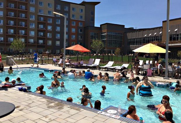 people in outdoor pool  NYC and NY hotel pools