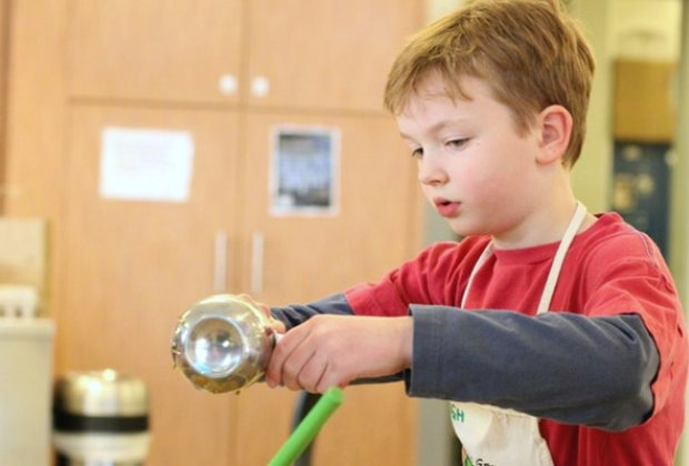 Children sharpen cooking skills in Kids in the Kitchen. Photo courtesy of The Trustees