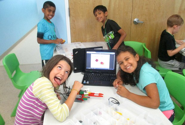 At L3 Academy young robotics campers build in a group using a design engineering process for feedback and evaluation