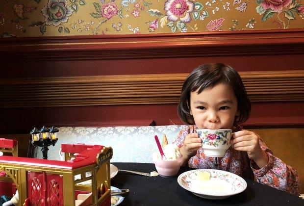 Child drinking tea at Lady Mendls