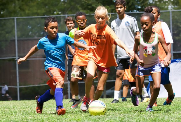 Try soccer, tennis, and more sports for FREE in the city's parks. Photo courtesy of the City Parks Foundation