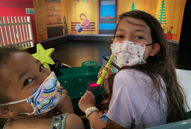 Girls with wands on Legoland Discovery Center's Imagination Express
