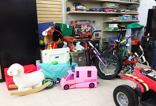Clearing out space in your basement? There are a host of Long Island charities that accept gently used toys and books. Photo by Thien August