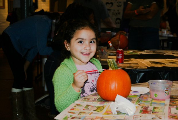 Cet creative with a pumpkin at Pumpkin Patch Day at Liberty Hall Museum. Photo courtesy of the event