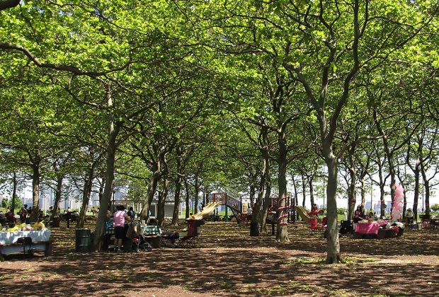 In addition to picnicking, Liberty State Park boasts a playground, riverfront paths, and stunning views of NYC. Photo by Ken Lund via Flickr