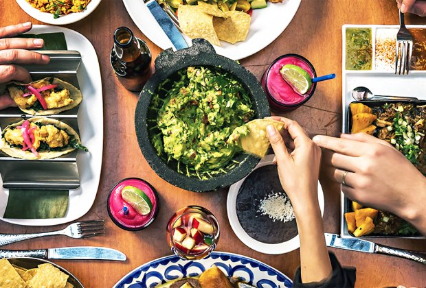 Dig into guac, beans and chips at Rosa Mexicano. Photo courtesy of the restaurant
