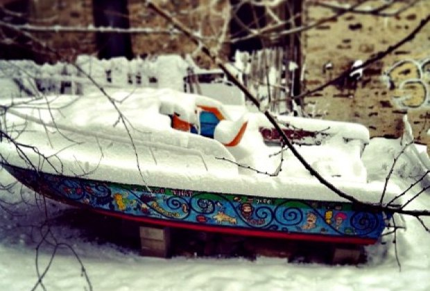 A picture (in winter) of the Marble Hill Avenue boat, which is actually in someone's yard!