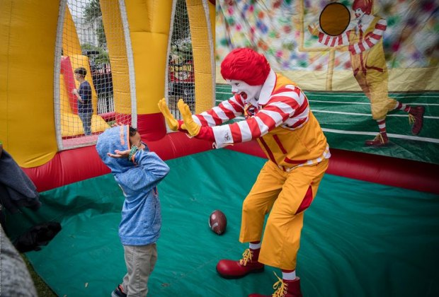 High fives all around with our favorite red-haired clown!/Photo courtesy of McDonald's Houston Children's Festival.