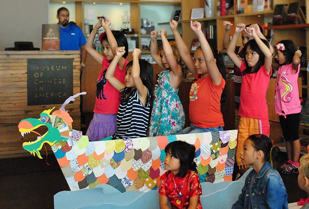 Kids get ready for Dragon Boat Festival by making their own craft.
