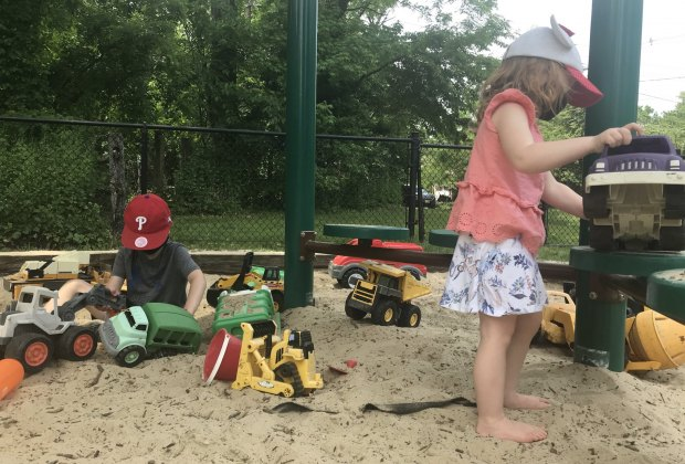Children play in the sandbox at Mountwell Park