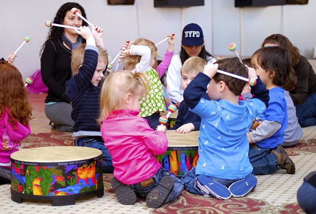 Kids feel the beat at a Musical Munchkins music class.