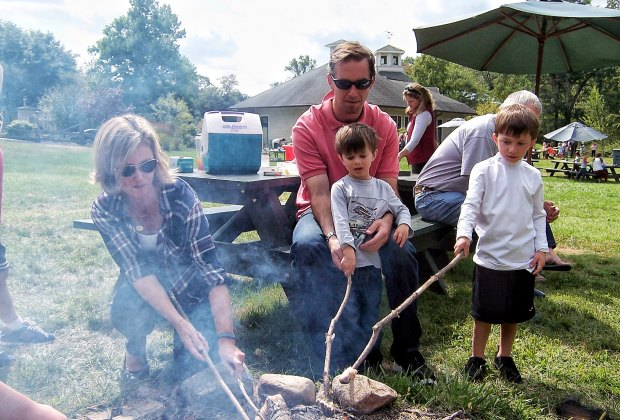 Families cook cornbread over the fire at Cider Saturday. Photo courtesy of New Canaan Nature Center