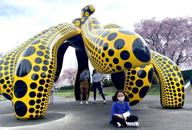 Girl under Yayoi Kusama installation at NYBG