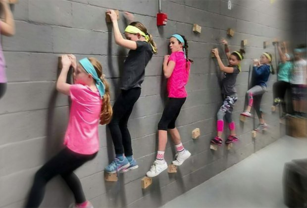 Rock-climbing classes at Obstacle Athletics teach kids discipline,  goal-setting, teamwork,  and more.