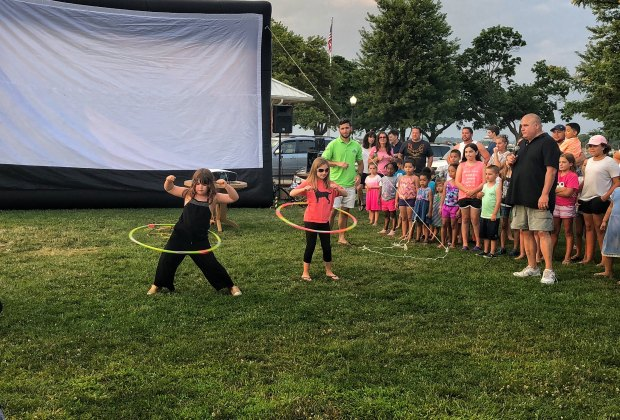 Enjoy a dance competition before the movie at Calf Pasture Beach.