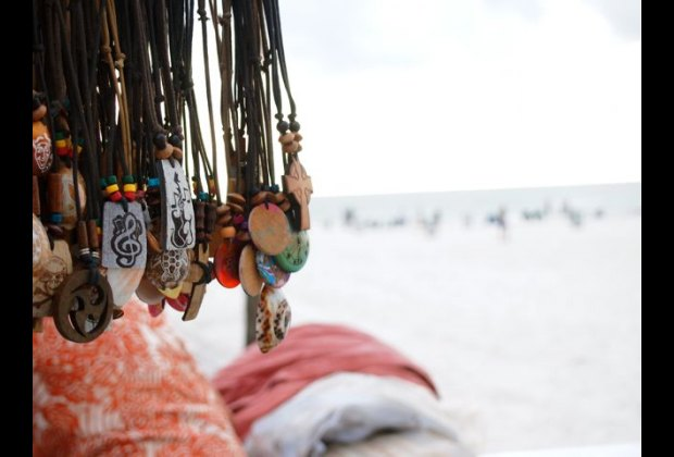 Crafts for sale along Pier 60 in the evening