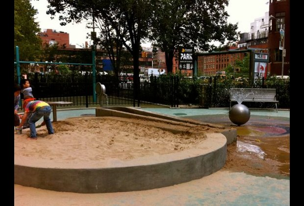Water play area and toddler swings