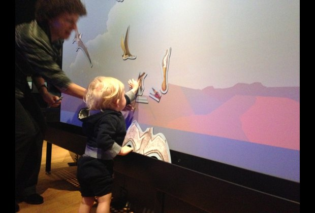 Overall, it's a pretty hands-on exhibit. Here's my boy connecting magnets to make a pterosaur