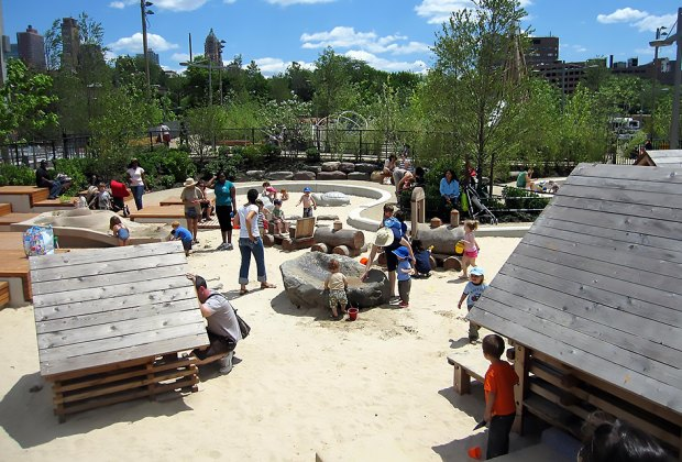 Sandbox Village at Brooklyn Bridge Park's Pier 6 is a sand city with playhouses and and a water spray area. Photo by Larry Kang via Flickr