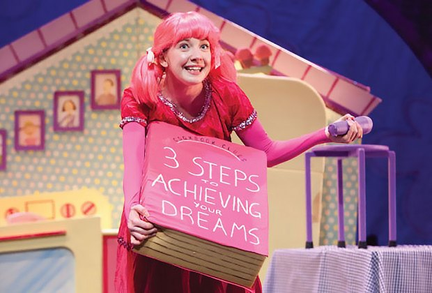 A girl finds herself in a colorful predicament after she indulges in too many pink cupcakes. Photo courtesy of the production