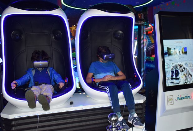 Two kids in virtual reality pods