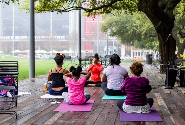 Yogis aged 10 and up can enjoy a special class that includes poetry being read aloud while performing yoga flows at Discovery Green. Photo courtesy of Sarah Nielson.