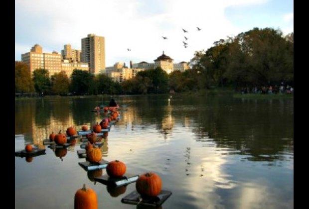 Jack-o'-lanterns floating on Central Park's Harlem Meer at the annual Halloween Parade & Pumpkin Flotilla