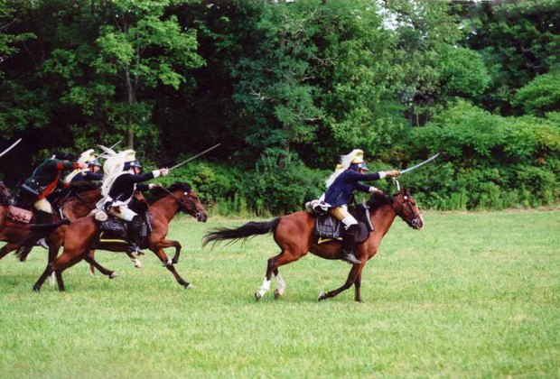 Watch the colonial militia in action at the Revolutionary War & Burning of Bedford Re-enactment . Photo courtesy of the Bedford Historical Societyy of the