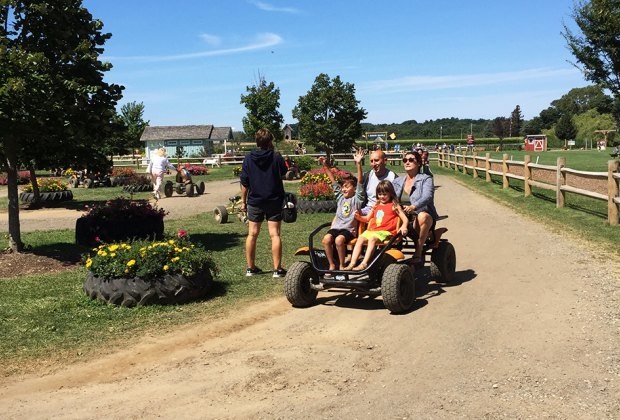 Enjoy a ride around the pedal track at Harbes Family Farm on the North Fork. Photo by Jaime Sumersille