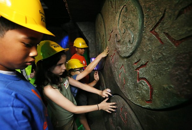 Kids embark on a quest at Ripley's Relic in Times Square. Photo by Stuart Ramson/AP Images