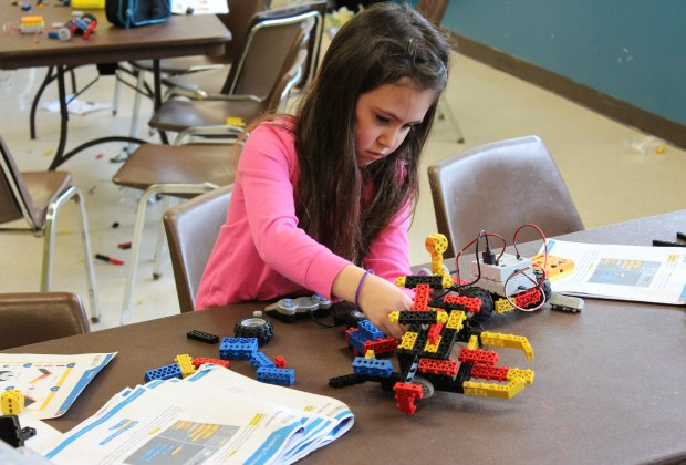 In RoboThink classes, kids learn to build and code robots. Photo courtesy of RoboThink