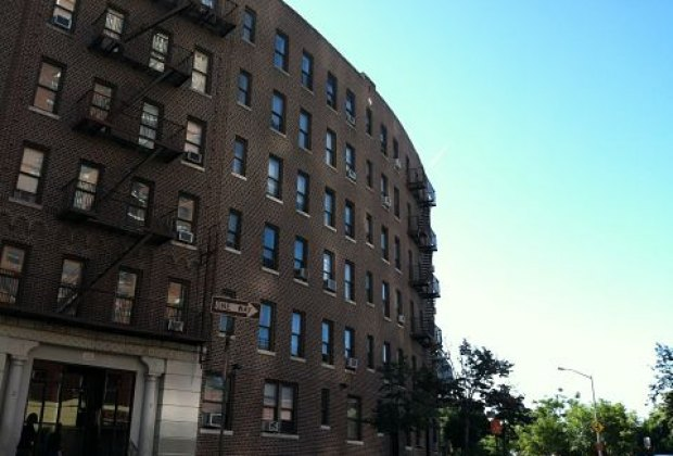 Stately apartment buildings with rounded facades...