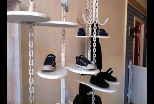 Instead of cubbies, kids place their shoes on cute suspended racks