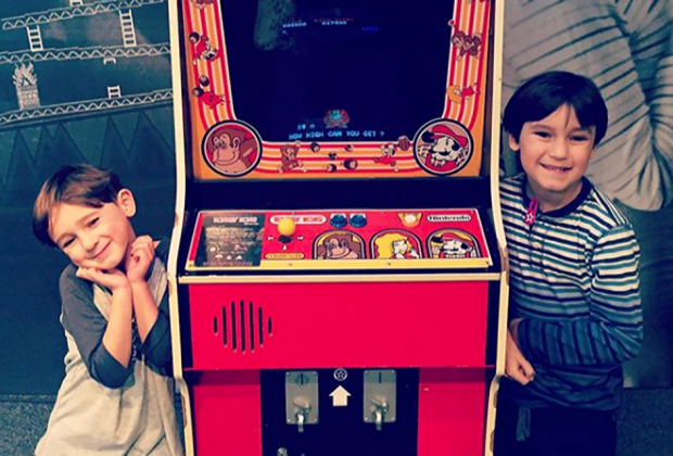 Show your kids some old-school joystick fun at the Long Island Retro Gaming Expo. Photo by the author
