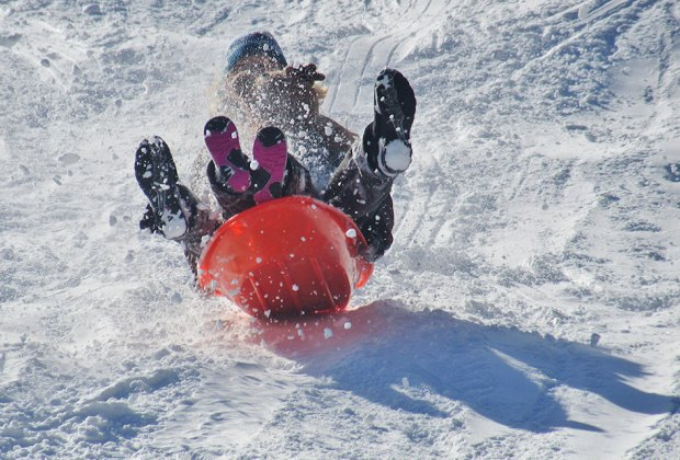 Sledding on the fresh snow with kids