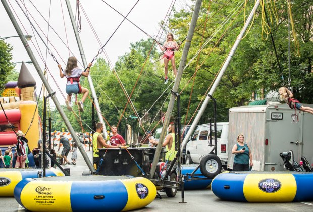 It's more than art at the Southport Art Festival: it's bouncy houses, bungee jumps, and plenty of other activities for kids. Photo courtesy of the fest