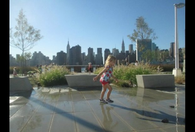 Outside the playground are other water features, like these gentle ground<br /> sprays near the dog run